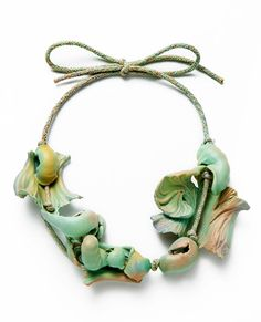 Ineke Heerkens. Necklace: Sunday Morning Sediment, 2013-2014. Ceramic, cotton, artificial silk. 240 x 210 x 40 mm. Hand shaped clay, spraying glaze, hand braided cord.