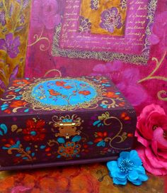 Paint a purple background and then color designs on those two wooden boxes.