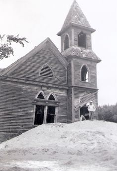 My father took this picture of the haunted church in July of 1958. It was located at Chappel Corners near Lake of the Woods, NY. Yes, that's me in the foreground.
