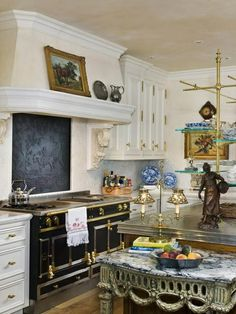 The Enchanted Home: Italianate fixtures and details..Love the backsplash behind the cook tip.