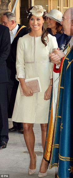 Flashback: Pippa also wore a similar outfit to the Duchess of Cambridge at Prince George's christening at St James's Palace in October 2013
