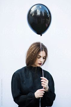 Young woman holding a black balloon by Jovana Rikalo for Stocksy United Girl Holding Balloons, Its A Girl Balloons, Black Balloons, Latex Balloons, Ballons Photography, Portrait Photography, House Of Balloons, Poses For Pictures, Cute Girl Photo