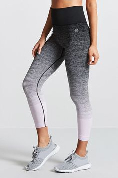 An pair of high-rise stretch-knit athletic leggings featuring a gradated contrast stripe print, ribbed waist, capri cut, and moisture management.
