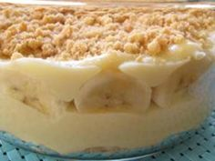 A rich from-scratch recipe for vanilla pudding layered with vanilla wafers and sliced bananas. Just like Grandma used to make! Banana Pudding From Scratch, No Bake Banana Pudding, Pudding Desserts, No Bake Desserts, Dessert Recipes, Vanilla Recipes, My Recipes, Cooking Recipes, Baked Banana