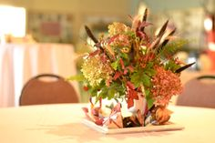 Hydrangeas, ninebark, millet and scented geraniums star in this fall-themed centerpiece for an early November wedding. Grown, designed and photographed by Buckeye Blooms.