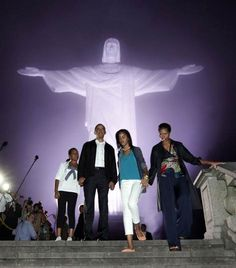 President Barack Obama with first lady Michelle Obama and daughters Malia and Sasha tour the Christ the Redeemer statue in Rio de Janeiro, on March 20, 2011.