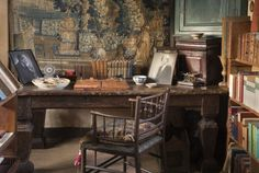 The desk in the Writing Room in the Tower at Sissinghurst Castle, Kent. The desk in the Writing Room in the Tower at Sissinghurst, home of Vita Sackville-West and her husband Sir Harold Nicolson, near Cranbrook, Kent. This room was Vita's sanctum where she wrote her books, poetry and gardening articles.