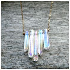 I made my own with clear crystals and silver :) just like this.....White Rainbow Crystal Point Necklace  on 14k Gold Filled Chain