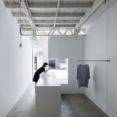 Designer Reiichi Ikeda inserted boxy partitions that follow the pattern of existing ceiling trusses into this clothing boutique in Osaka, Japan