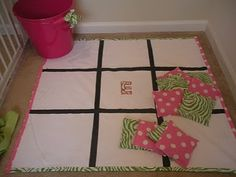 DIY floor tic-tac-toe game-this would be a great game to take on the go too with a travel bag