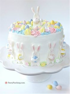 Easter Bunny Egg Hunt Cake, cute pastel Easter Cake, beautiful adorable pretty Easter cake, fondant bunny cake, Bunnies holding eggs, pastel Spring flower cake, Best Easter cake recipe