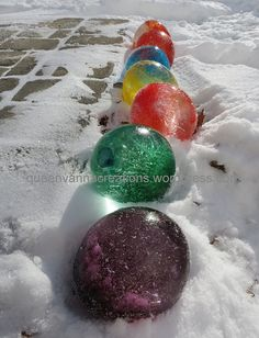 ice balloons.  So simple just fill the balloons with water ads food  coloring ans let mother nature take it from there. Peel the balloons away once frozen and  ... ICE marbles!
