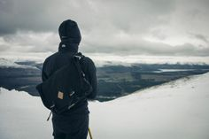 Niall Walker looks out over Glencoe, Scotland with his Wee Lug messenger bag.