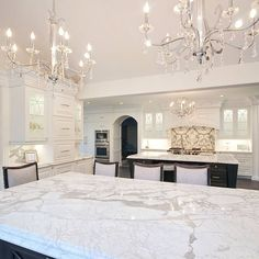 Love the chandeliers!!!! Great idea to bring clean elegance to the kitchen.