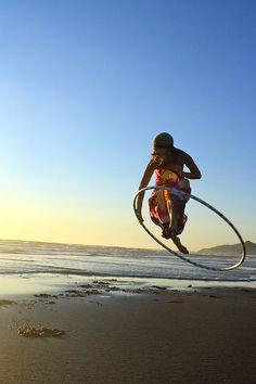 """""""Ashley Stroh leaps into it in this stunning shot taken at the beach in Nehalem Bay, Oregon. Photo by her sister Briana Stroh of Violette Portraits. A Hooping.org Photo of the Day. """""""