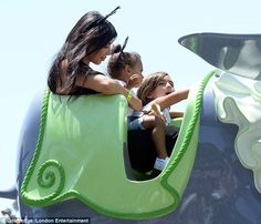 All hands on deck: Mason got to grips with the controls while North had her hands full wit...