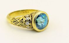 """Reed"" ring in yellow gold by Alex Sepkus, here set with a brilliant blue zircon that weighs carats and ten side diamonds. Blue Zircon, Yellow Gold Rings, Gemstone Rings, Diamonds, Turquoise, Jewels, Studio, Stones, Fashion"