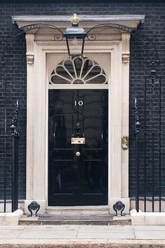 the most seen front door in England - 10 Downing Street London Lion Door Knocker, Door Knockers, Door Knob, Portal, Black Front Doors, Number 10, Fake Number, Secret Places, Hidden Places