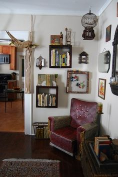 Janice & Jacob's Home of Magical Curiosities - I like the cubes as small hanging bookcases. Creative and efficient use of space.