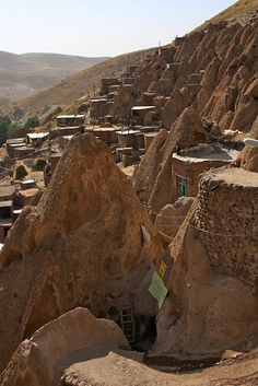 Kandovan (or Candovan) is a tourist village in the province of East Azarbaijan, near Osku and Tabriz, Iran. Some of the houses are at least 700 years old and are still inhabited.  Its mineral water is also popular with visitors and is believed to be a cure for kidney disease.