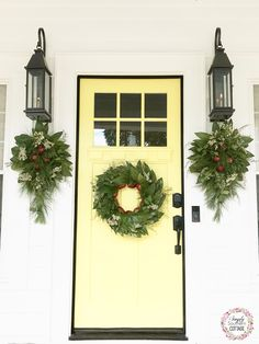 Christmas front porch decor. Custom magnolia wreaths and swags. Yellow front door.