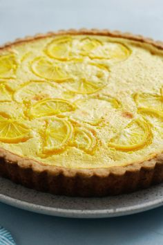 "NYT Cooking: Somewhere between a lemon bar and a lemon pie lies this ultra tangy tart. ""Tart"" makes it sound difficult, but it's easier than you think: The rich filling requires zero cooking, and the crust is a simple shortbread that you just press into place. The already vibrant yellow filling gets an assist from a bit of ground turmeric. It's an ingredient that you won't taste as much as you'll see, but i..."