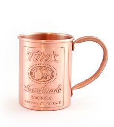 $15.00 Tito's custom Moscow Mule 100% 12 oz copper mug with a protective coating to keep it from tarnishing
