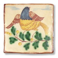 <h3>This Sicilian tile depicts a bird on branch.</h3><br /> <p>The tile is entirely handmade and hand painted in Caltagirone by Giacomo Alessi, one of the most relevant ceramic artists in Italy. <br />Gracefully hand painted with traditional Sicilian subjects, the tiles made by Giacomo Alessi have that particular, witty simplicity that is quintessentially Sicilian. For his Collection 1800 Alessi draws inspiration from the subjects of the pottery made in Caltagirone in the 19th century.</p>