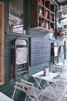 Hang your extra chairs on the wall. #decoration #restaurant #interior