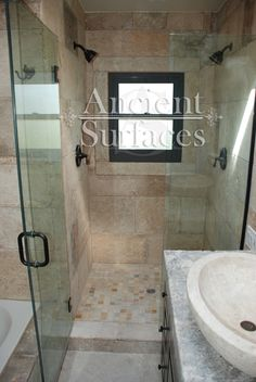 Bathrooms and showers stone floors, walls and counters By Ancient Surfaces. Call us at (212) 461-0245 for info and prices, or visit our site at: www.Asurfaces.com