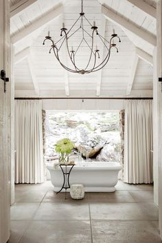 Master Privacy and Light | These lake house decorating ideas will help create a serene oasis, expertly blending with the beauty of nature all around. There's something so nostalgic about lake houses—memories of hot summers spent by the lake, autumn getaways to see the rich fall foliage. Lake houses are the de facto settings for big family gatherings, girlfriend getaways, and celebratory weekends. So shouldn't a lake house be a place that draws people in, wraps them up, and invites them to…