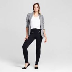 Comfort meets fashion with these Zipper Black Ponte Pants from A New Day™. Designed with a trendy take on classic black slacks, these pants fit close to the body — accentuating your figure — and are accented with two front zippers that bring shine and appeal. Head to work in pointed-toe flats and just throw on a jean jacket for when you meet up with friends later to instantly take your look from day to night.
