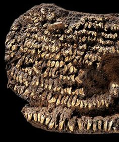 world's oldest handbag, buried in a grave dating somewhere between 2500 and 2200 BCE / covered in dog teeth. Amazing