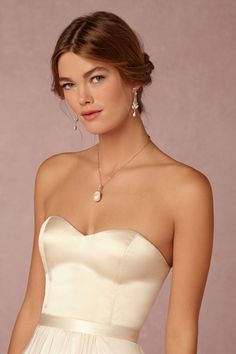 strapless camisole that can be worn under a lace topper