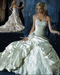 Maggie Sottero Quick Delivery Wedding Dresses - Style Ambrosia A3365HC    Description: Maggie Sottero Wedding Dresses, Spring 2010. Full bustled gown with dipped neckline and corset closure. The glamour of embellished lace accents the bodice, as a sensational fit through the hip area combines with caught-up detailing throughout the Soft Shimmer Satin skirt. A romantic lace inset panel is punctuated with handmade flowers that are also nestled within bustled train.  Price: $1,649.00