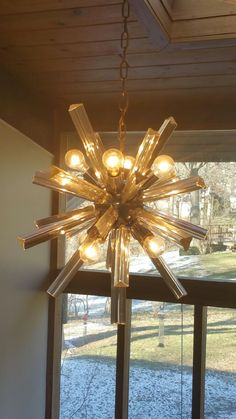 Vintage Mid-Century Murano Glass Chandelier Amber says: Here is another Murano glass chandelier I'd like you to appraise. The glass rods are thicker than the ones on the chandelier I previously submitted. There are 8 bulbs. AW says: This piece is obviously made by the same designer, and although at this time we don't …