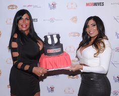 "Angela ""Big Ang"" Raiola and her ""Mob Wives"" co-star Natalie Guercio attend the Season Five Viewing Party at Ang's bar Drunken Monkey on Dec. 3, 2014 in New York City."