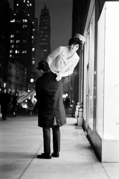 Man carrying a Jacqueline Kennedy mannequin, New York City, 1961.