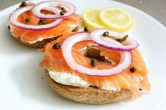 lox appetizer with red onion, capers, cream cheese & lemon.