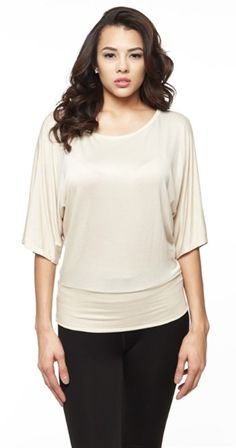 Wide sleeves, a scoop neck and a banded hem elevate this top to the height of flattering style, while the soft, stretch fabric promises an effortless fit. Dolman Top, Tunic Tops, On Repeat, Fashion Company, Half Sleeves, White Tops, Chic Outfits, Fashion Online, Dress Up