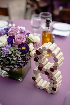 Purple wedding centerpiece idea; Featured Photographer: Viera Photographics