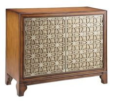 The Como Accent Cabinet bring a welcome presence to any home. With its raised textured facing on the doors panels, this distinguished looking piece will fit a variety of decors. Finished in a warm wood tone, this cabinet is a must-have for every home.