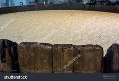 An Aged Tank Holds Bourbon As It Ferments Before Being Distilled 写真素材 447433165 : Shutterstock Bourbon, Ottoman, Stock Photos, Home Decor, Bourbon Whiskey, Homemade Home Decor, Decoration Home, Interior Decorating