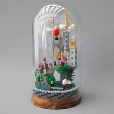 https://flic.kr/p/Uq8QrZ | Micro Scale Castle in Glass Dome 1 | I bought the IKEA HÄRLIGA glass dome for some time ago to build a fantasy MOC for my new work office. But I've had a Builder's Block (Writer's block) for a while now. But then I saw Yang Wang's Build on TBB and I got my inspiration back. Thanx 4 that!  A great thing with this kind of MOC is that you can put it anywhere and it will stay free of dust.
