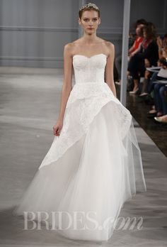 """Brides.com: Monique Lhuillier - Spring 2014. """"Azure"""" silk white Chantilly lace strapless gown with asymmetric horsehair peplum and full tulle skirt, Monique Lhuillier"""