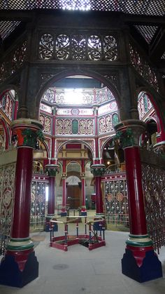 The four engines are placed in the corners of the building, the centre of which is occupied by an octagonal structure of iron columns with richly ornamented capitals, supporting iron arched screens and the open octagonal well on the main beam floor