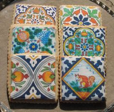 Delft tile prints on vanilla sugar cookies.  As much as I love cookies, I'd have a hard time taking a bit out of one of these.