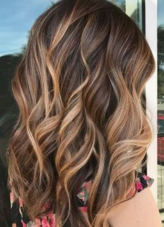 Fall hair color inspo: A perfectly executed balayage to give this client caramel, sunkissed highlights.