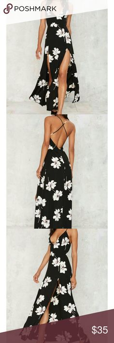 Pick Me Up Slit Dress The Pick Me Up Dress is black with a white floral design and features a plunging neckline, strappy detailing and enclosed zipper at back, maxi lenght, and front slits. Partially lined.  *Polyester? Nasty Gal Dresses