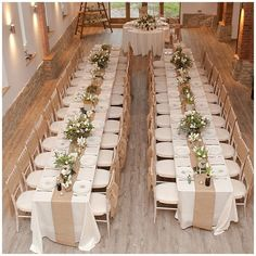 burlap table runners, white flower centerpieces